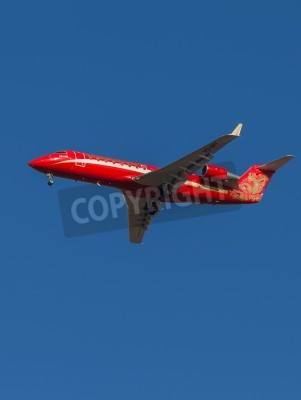 Wall mural Domodedovo - March 17, 2015: Red Passenger Aircraft Bombardier (Canadair) CRJ-200 airline Ruslayn Airlines landing at Domodedovo airport March 17, 2015, Domodedovo, Moscow Region, Russia