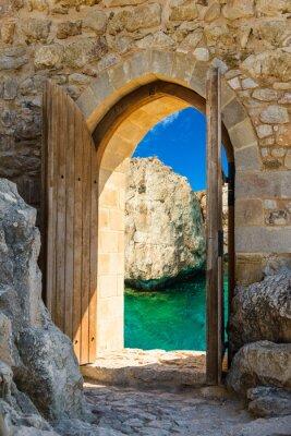 Wall mural door open sea