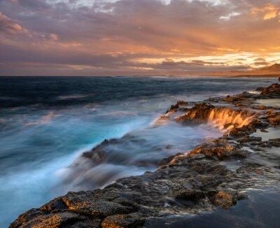 dramatic sunset over the rocky cliffs of Fuerteventura