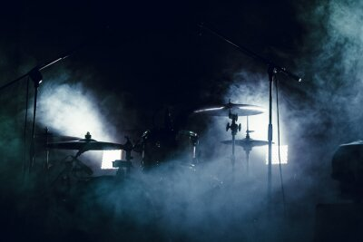Wall mural Drum set in smoke on a stage