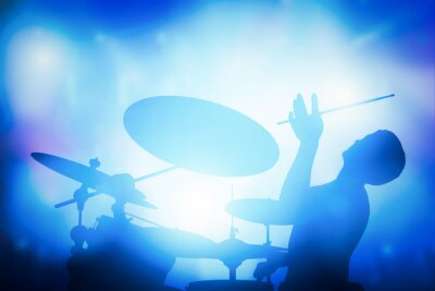 Wall mural Drummer playing on drums on music concert. Club lights