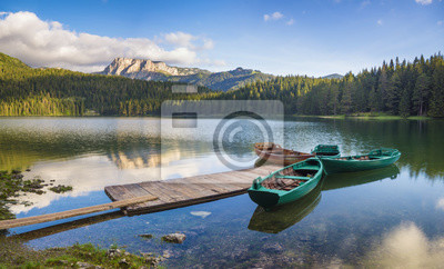 Durmitor National Park, Montenegro,sunrise over a mountain lake, the peaks of the mountains lit by the rising sun