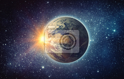 Earth, sun, star and galaxy. Sunrise over planet Earth, view from space. Elements of this image furnished by NASA