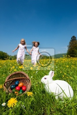 Easter - Rabbit on lawn, children looking eggs