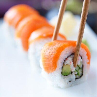 Wall mural eating sushi with chopstricks