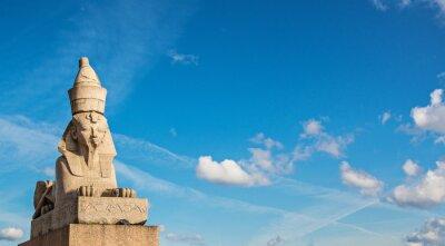 Egyptian sphinx against blue sky on  University Embankment in St. Petersburg