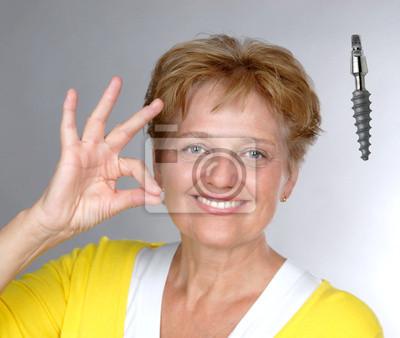 elderly woman with gesture OK dental implant