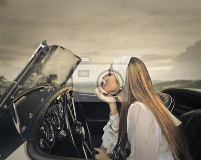 Elegant woman in a vintage car