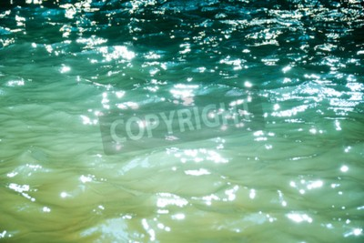 Wall mural Emerald green water reflect light abstract background