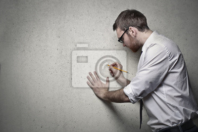 Employee writing on a blank wall
