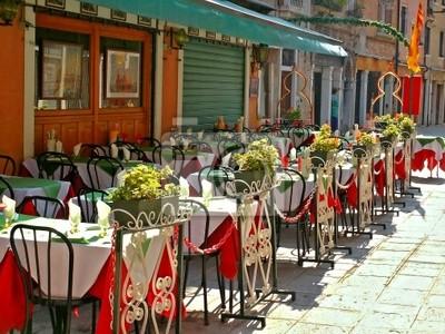 empty tables of sidewalk cafe