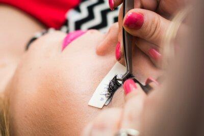Wall mural eyelash extension in a beauty salon