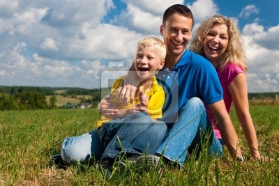 Family sitting on meadow