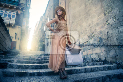 Fashionable girl doing shopping in a sunny day