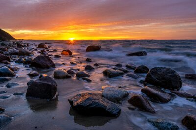 Fiery sunset over the Baltic shore.