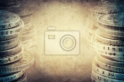 Finance concept. Old silver coins on vintage background.