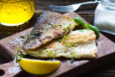 Wall mural Fish Fillet with olive oil and lemon
