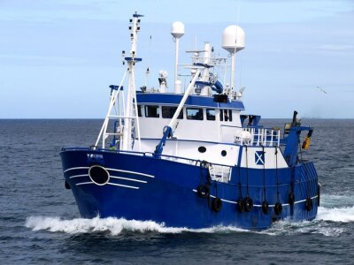 Wall mural Fishing Vessel 15b, Fishing Vessel underway to harbour to land fish.