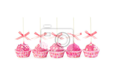 Five romantic pop cake with pink frosting, decorative sprinkles and pink ribbons