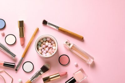 Wall mural Flat lay composition with products for decorative makeup on pastel pink background