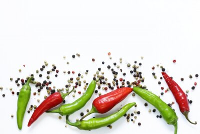 Wall mural Food background, red and green chili pepper on white background