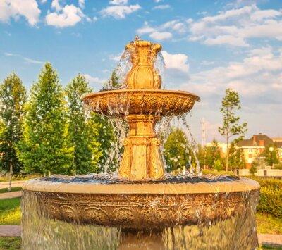 Fountain in  city summer park