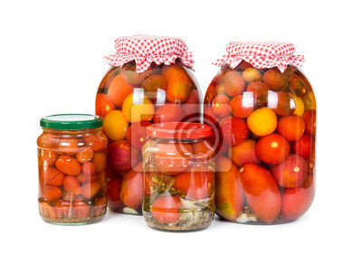 Four jars of pickled tomatoes  isolated on white