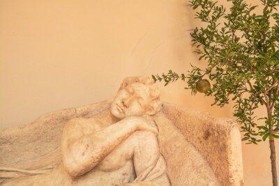 Fragment of ancient ancient sculpture depicting sleeping Venus