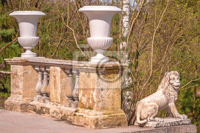 Fragment of  ancient Italian staircase with  marble lion in Pavlovsky park