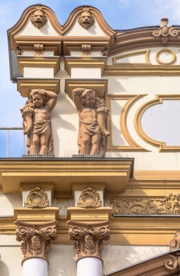 Fragment of  facade of  old building decorated with stucco and sculptures