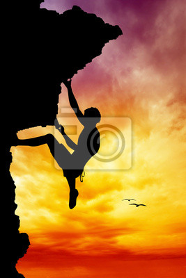 Free climber silhouette at sunset