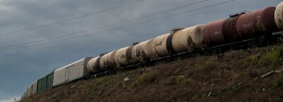 Wall mural Freight train. Train freight - Cargo railroad industry. Freight wagons. Grunge landscape