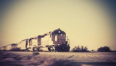 Wall mural Freight train traveling through desert Arizona