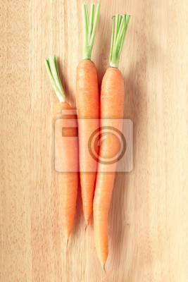 Wall mural Fresh carrots on cutting board