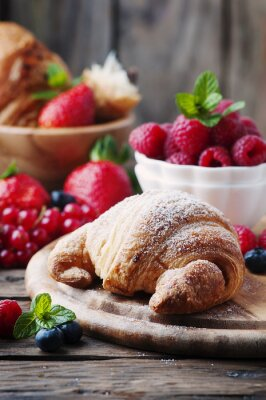 Wall mural Fresh croissant with mix of berry