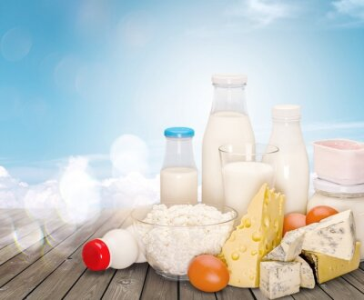 Fresh dairy products on wooden desk