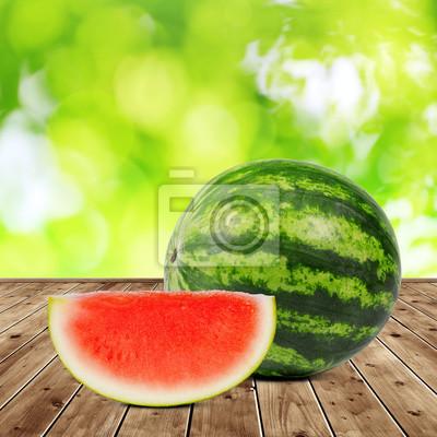 Fresh green melon on wooden desk.