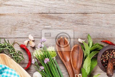 Wall mural Fresh herbs and spices on garden table