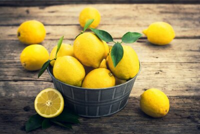 Wall mural Fresh lemons on the rustic tale