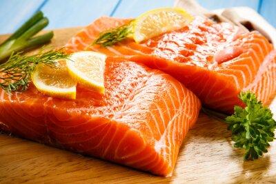 Wall mural Fresh raw salmon fillets on cutting board