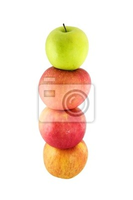 Fresh red apples stacked on top of one another with a green appl