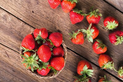Wall mural Fresh red strawberries on old wooden background