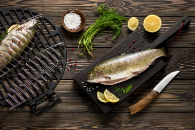 Wall mural Fresh whole trout fishes prepared to grill top view