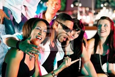 Friends in disco or nightclub