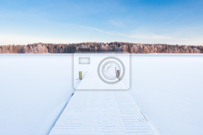 frozen snowy lake and a pier