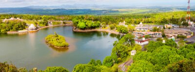 Wall mural Ganga Talao also known as Grand Bassin crater lake on Mauritius. It is considered the most sacred Hindu place. There is a temple dedicated to Lord Shiva, Lord Hanuman, Goddess Lakshmi and others Gods.