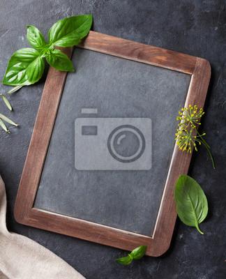 Garden herbs and blackboard