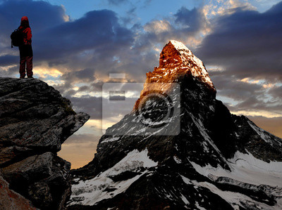 Wall mural girl looking at the beautiful Mount Matterhorn