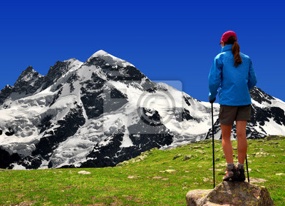 girl looking at the  Breithorn in the Swiss Alps