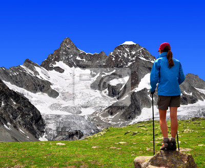 girl looking at the  Mount Gabelhorn in the Swiss Alps